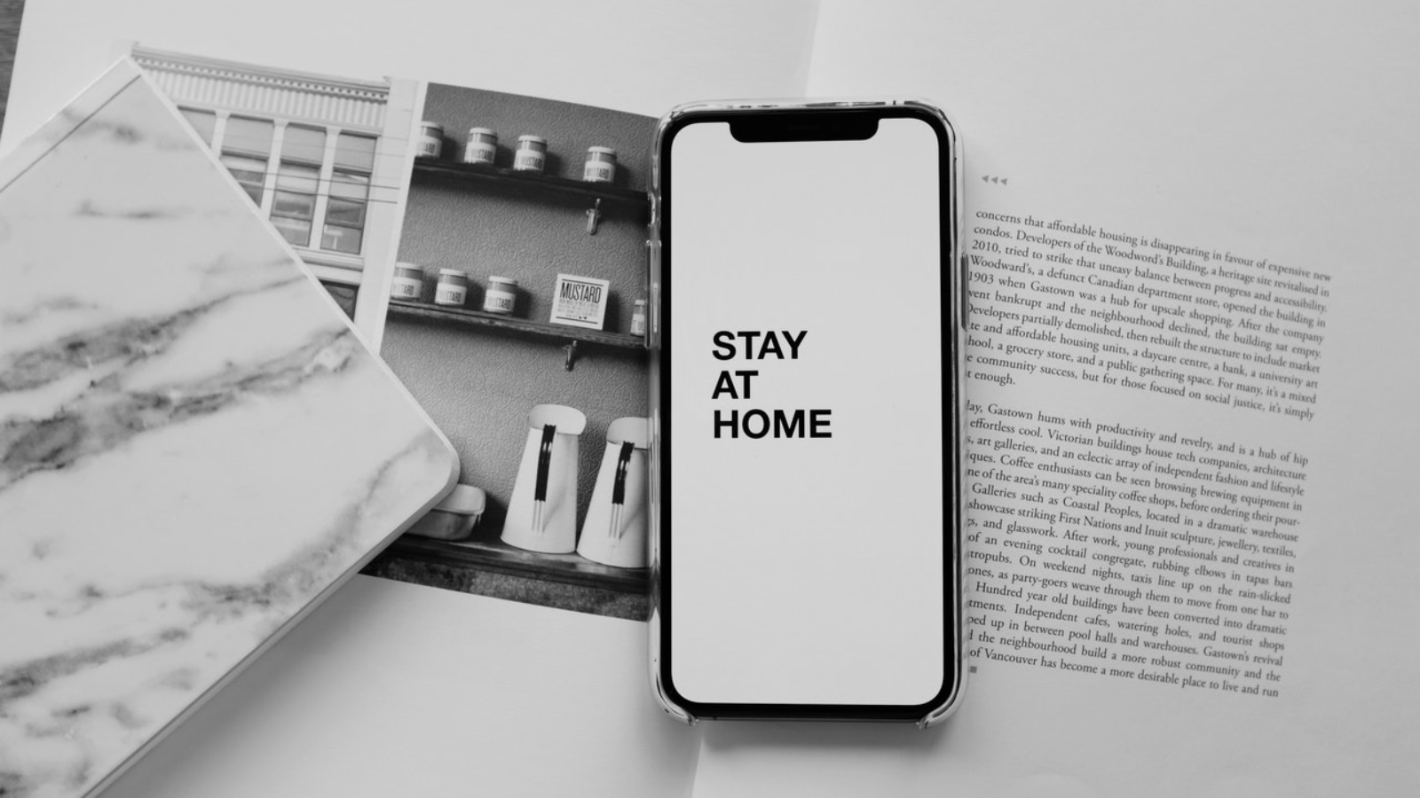 Smartphone on an open Book - Stay Home